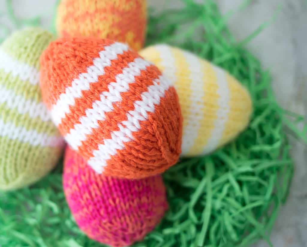 05e543203386 Easy Easter Eggs Knitting Pattern- a quick project that s perfect for decor  and Easter baskets! These knit easter eggs are knit flat and they make a  great ...